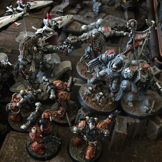 The grey clad warriors of the Vlka Fenryka are confronted on all sides by a sea of red.